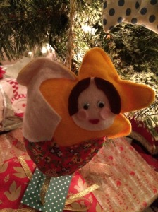 This hand-stitched little guardian keeps watch at the foot of our tree.