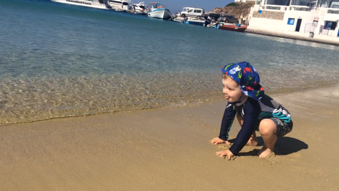 Simon digs his toes into the Mykonian coastline (before sand-flinging and cup-digging commenced).